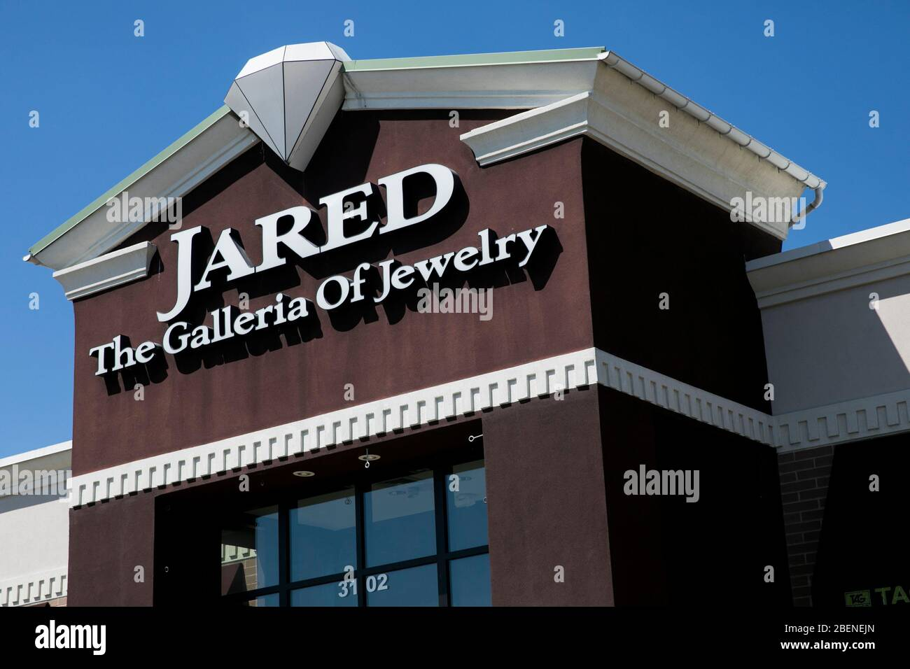 A logo sign outside of a Jared The Galleria Of Jewelry ...